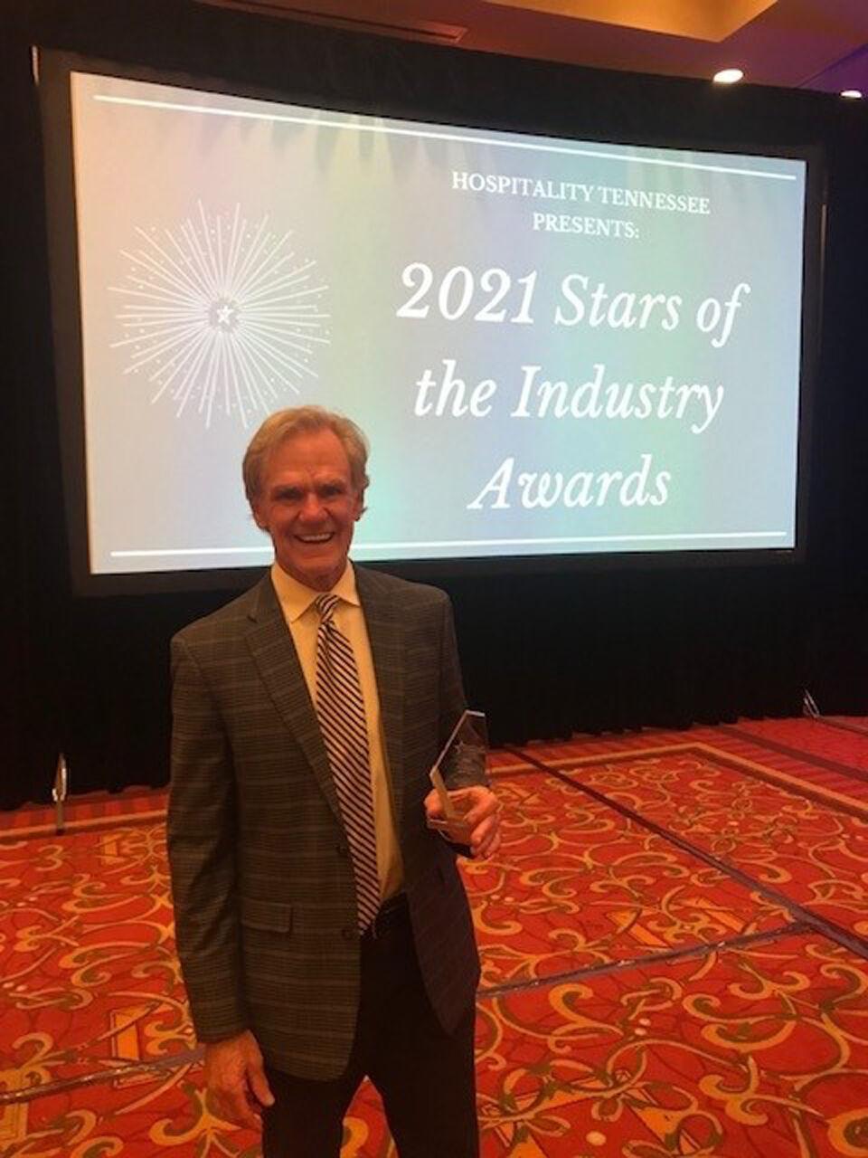 Logan McCabe accepting BMS award at HTN 2021-HR