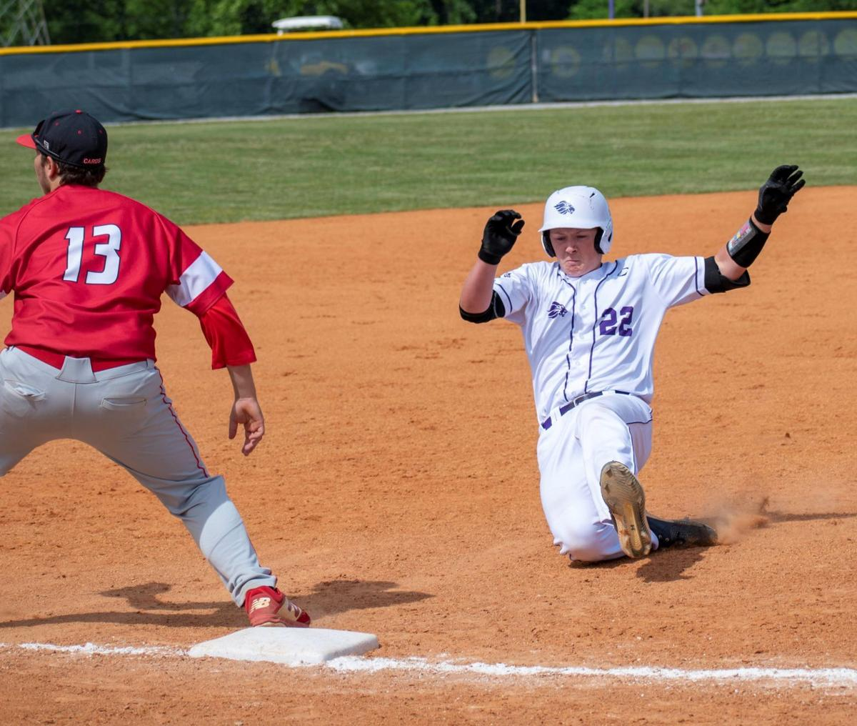 Brody Williams slides into 3rd hitting a triple against Livingston