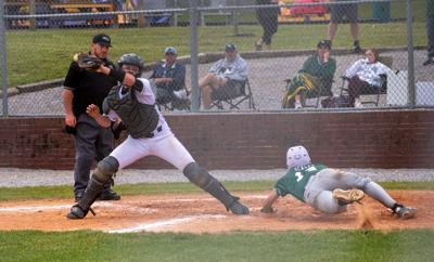 Brody Williams fields the ball at home as owensboro catholic sneaks a run