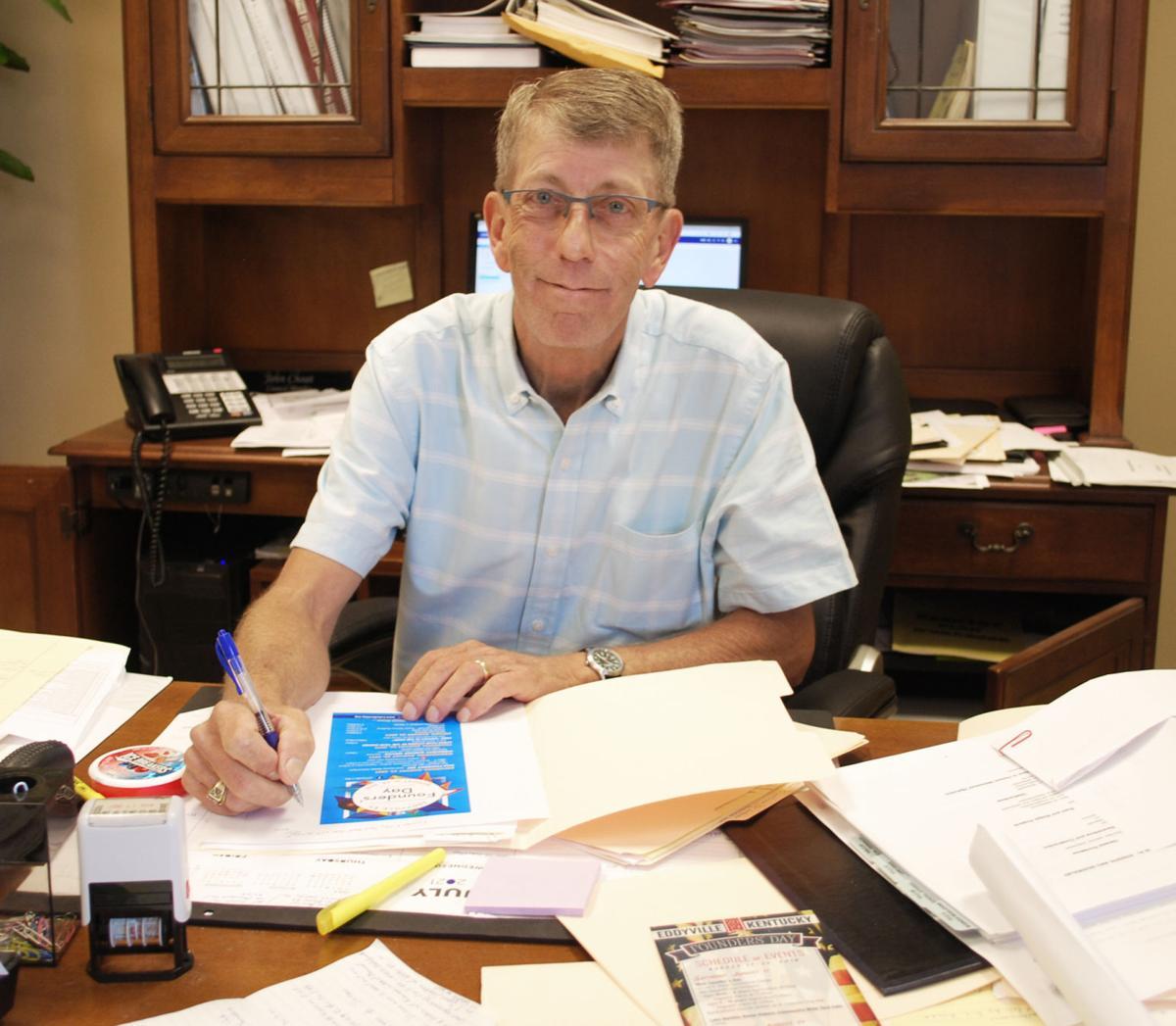 Mayor John Choat works at his desk