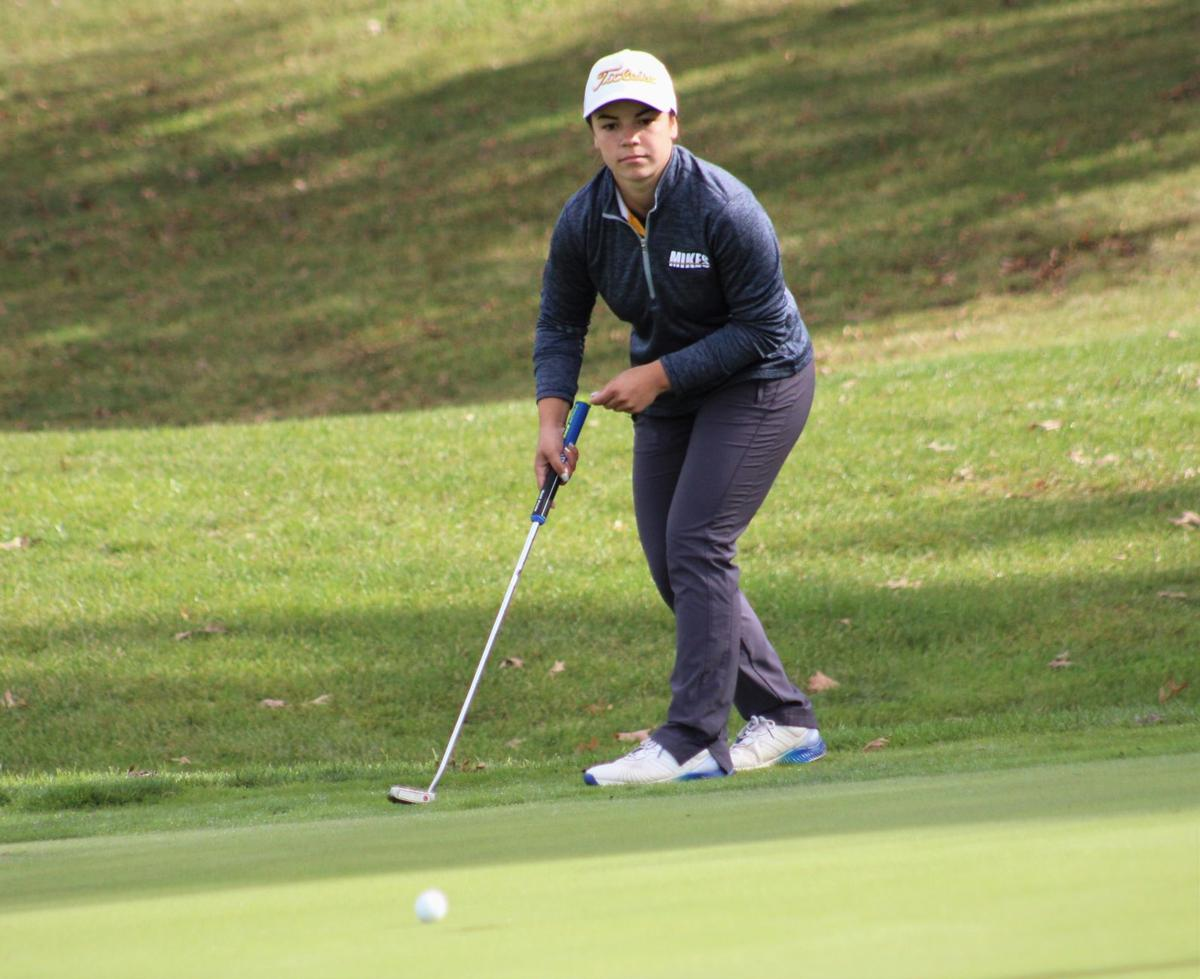 Lohr reacts to her putt