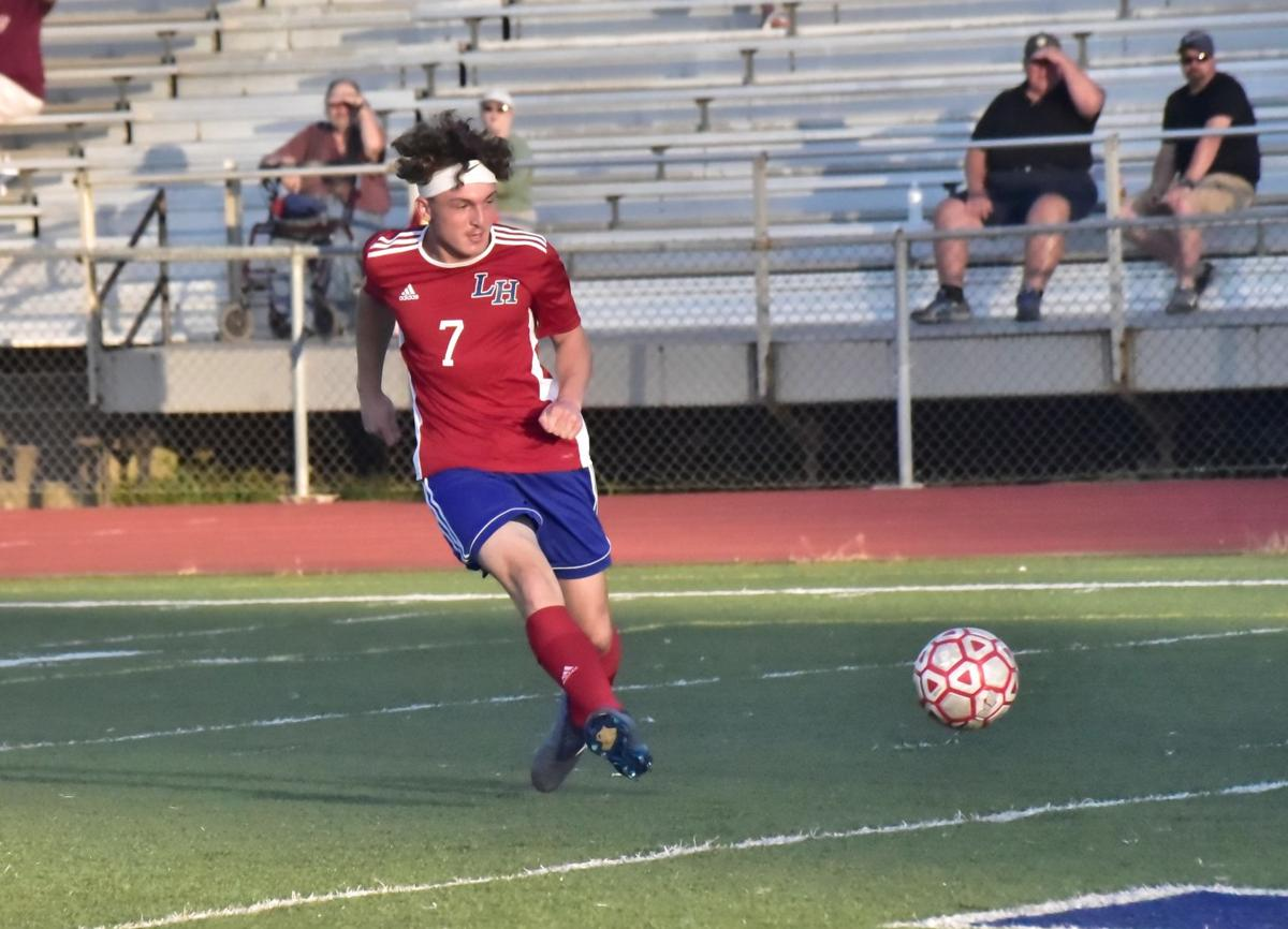 Mustangs' Livingston with the 1st of 3 goals