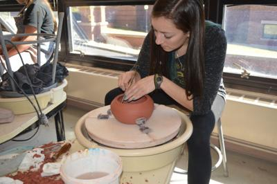 Students and community members work together to create handcrafted bowls