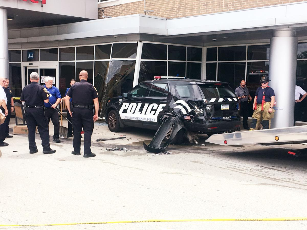 Driver injured after hitting police vehicle into Uniontown Hospital