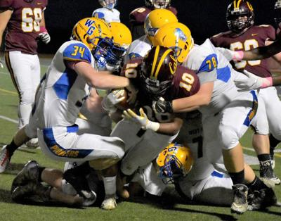 Trojans' Ryan tackled by three Pioneers