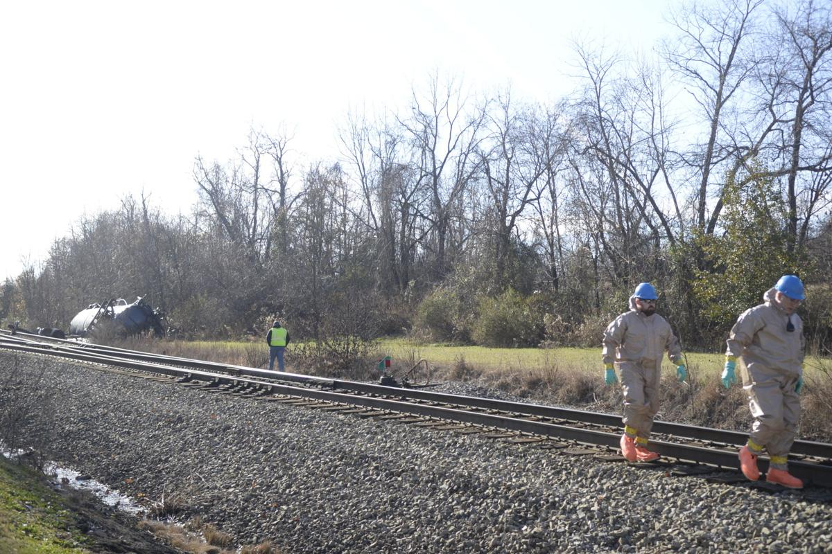 Hazmat crews respond to flammable liquid spill after train car overturns