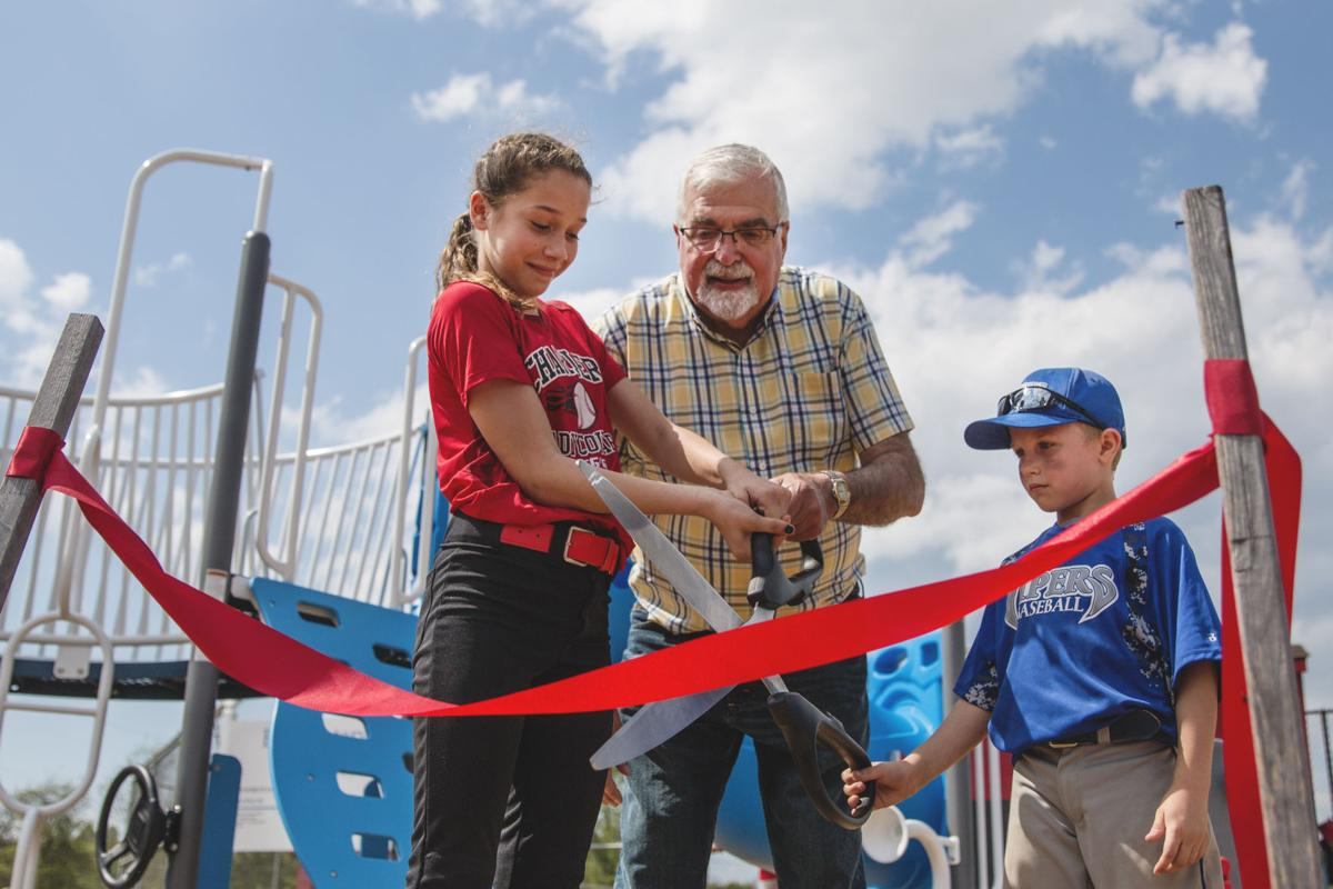 Local kids help in the ribbon cutting