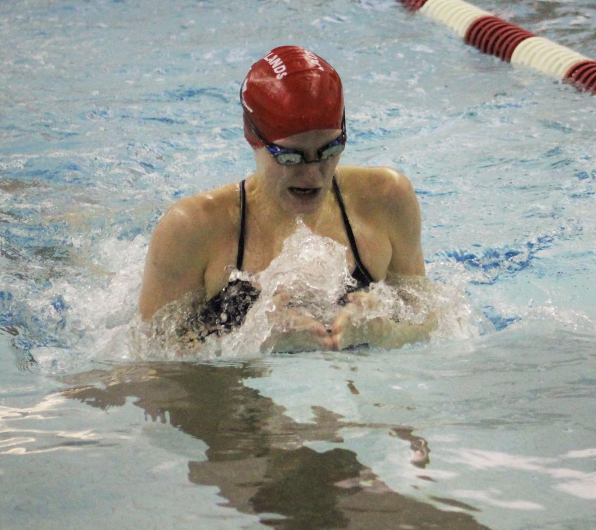 Thomas swims the breaststroke leg