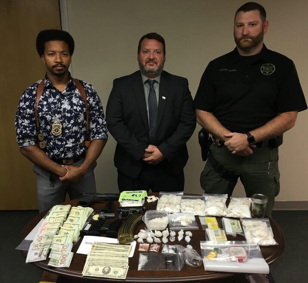Law enforcement agencies seize drugs, cash, weapons in raid