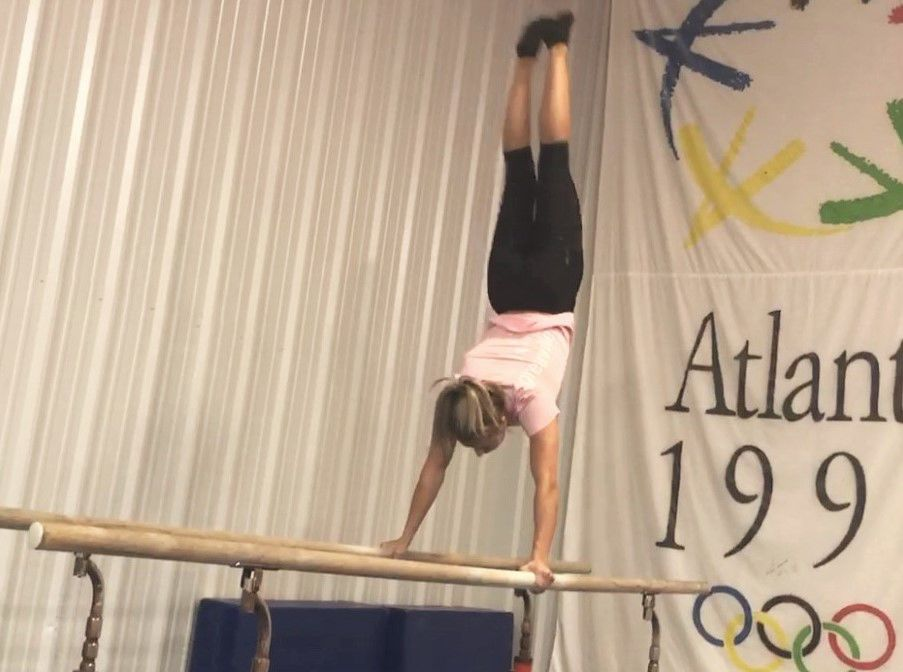 Kalsey works on the parallel bars