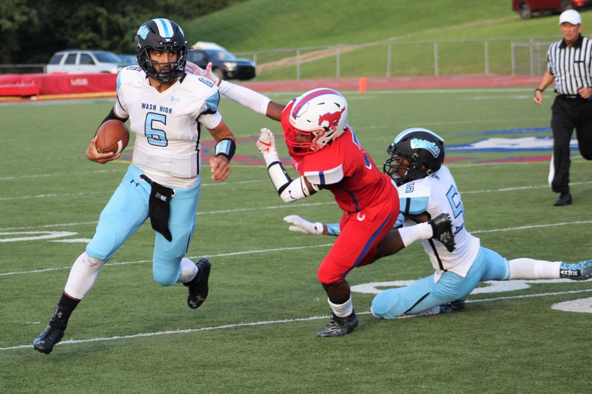 Swartz fights through the tackle