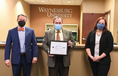Two WU employees recognized for support of faculty member's military service