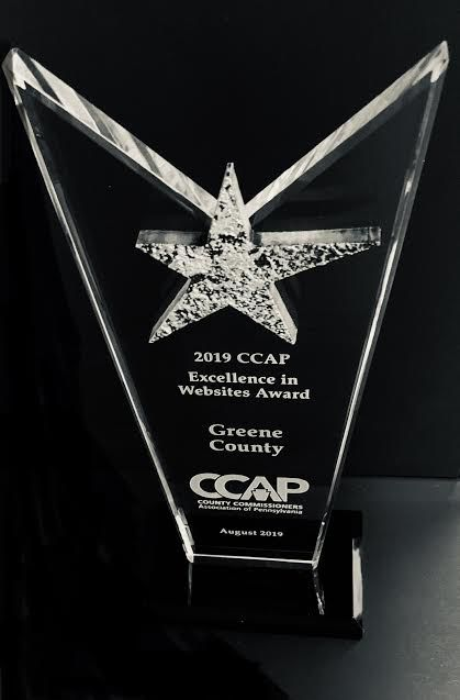 Commissioners accept CCAP Award for county's improved website