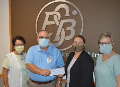 A $1,438 check was presented Thursday afternoon by Peoples Savings Bank