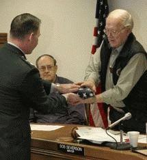 Hill presents flag to city of Hermiston