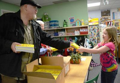 Columbia Grange donates dictionaries to third-graders