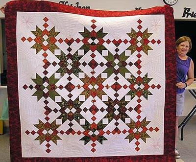 Seamstresses sew up raffle quilt