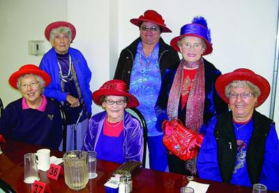 Colored like cardinals, ladies gather for fun