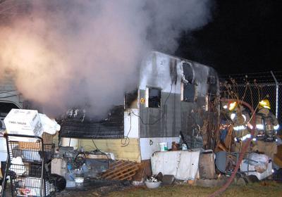 Fire burns trailer in RV park