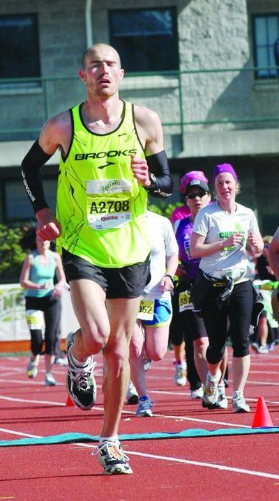 Jake Puzey runs at the Eugene Marathon Sunday