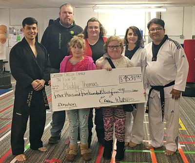 Taekwondo studio crushes fundraiser for Echo girl