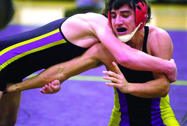 Wrestlers fire up home crowd at dual