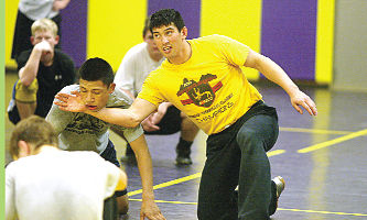 Wrestling team calls on experience to fuel quest for fifth-straight title