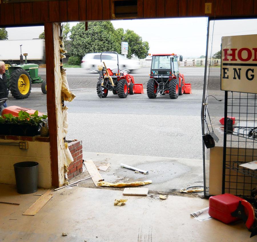 Thief drives vehicle through store doors