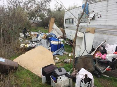 Homeless camp clean-up tops two tons