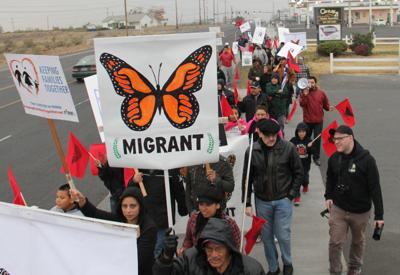 Community members march in support of immigration reform