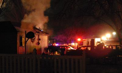 Ten people escaped from house fire uninjured
