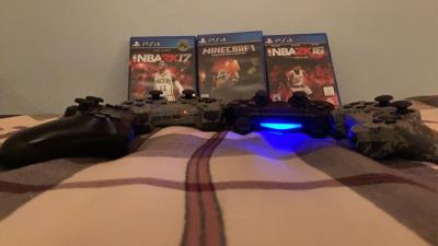 Picture of PS3 and PS4 controllers and games