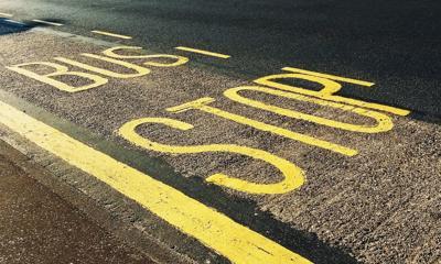 bus-stop-printed-on-asphalt-road-1260437.jpg