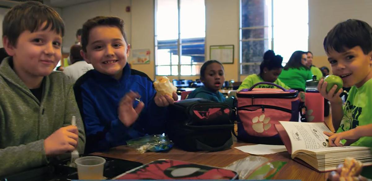 Kids eating at school.JPG