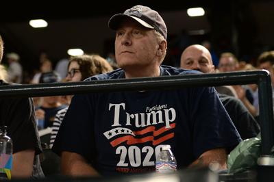 Curt Schilling watches a 2018 game between the San Francisco Giants and Arizona Diamondbacks at Chase Field in Phoenix.
