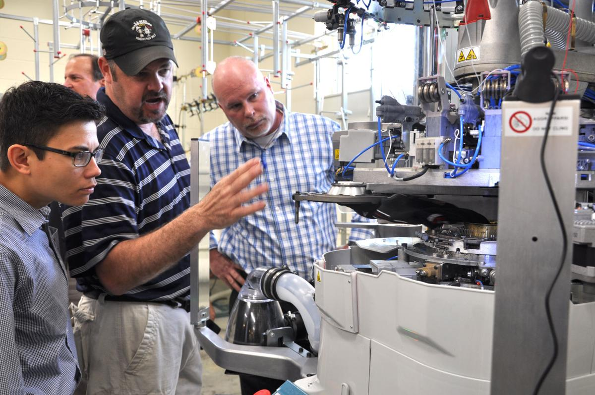 Hosiery equipment manufacturer showcases machines in Conover   News