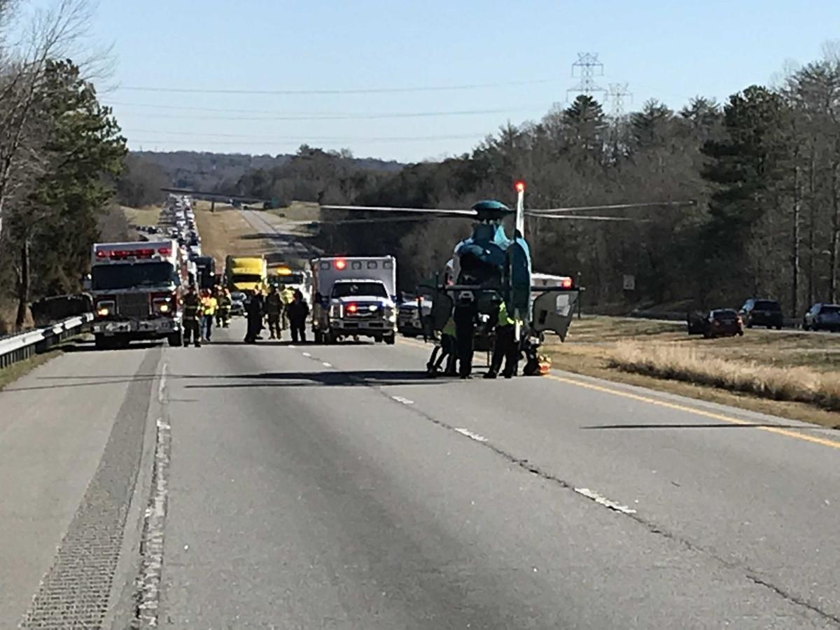 Helicopter arrives at wreck scene to airlift victim