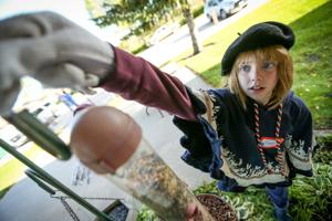 Charlie Johnson installs a bird feeder