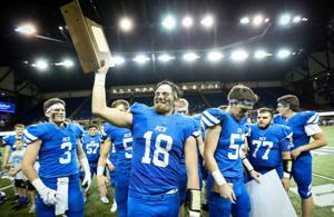 Landen Reed hoists the trophy