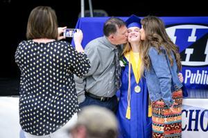 "<p class=""p1"">Hillsboro High School senior Mattison Matthys receives a kiss from parents Jeff Matthys and Kari Matthys before Hillsboro's graduation ceremony Sunday inside the Hillsboro Events Center.</p>"