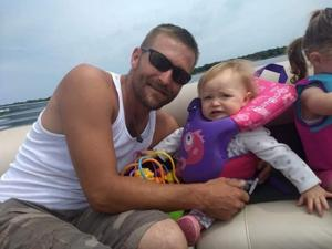 Adam Gettel and his daughter, Anja