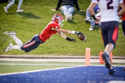 Ethan Bergstrom dives for a touchdown