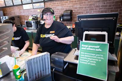 Melissa Stuart serves a customer (copy)