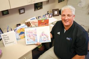 Like-an-open-book:-Hillsboro-Elementary-Principal-Dryburgh-enjoying-reading-to-kids-on-Facebook-Live