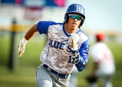 Cole Hebl sprints to third base