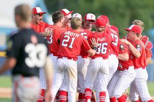 Mayville Post 8's American Legion team crowds around pitcher Reese Hanson