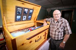 Ed Olsen and the wooden funeral casket he crafted