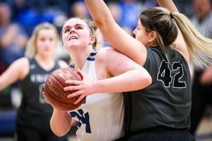 Abby Magnuson muscles up a shot in the lane