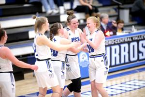 Erin Sondrol celebrates with teammates