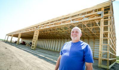 Larry Mueller in front of new hangars